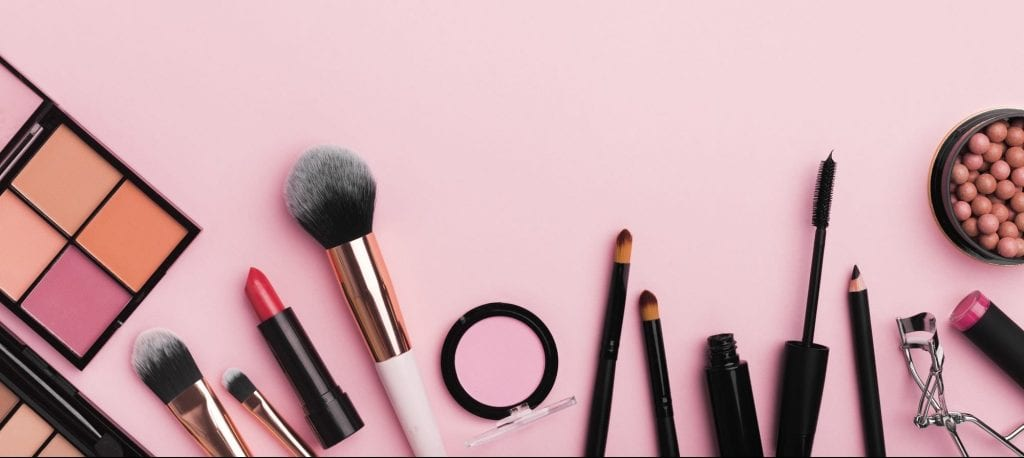 Organic cosmetics for makeup banner on light pink background